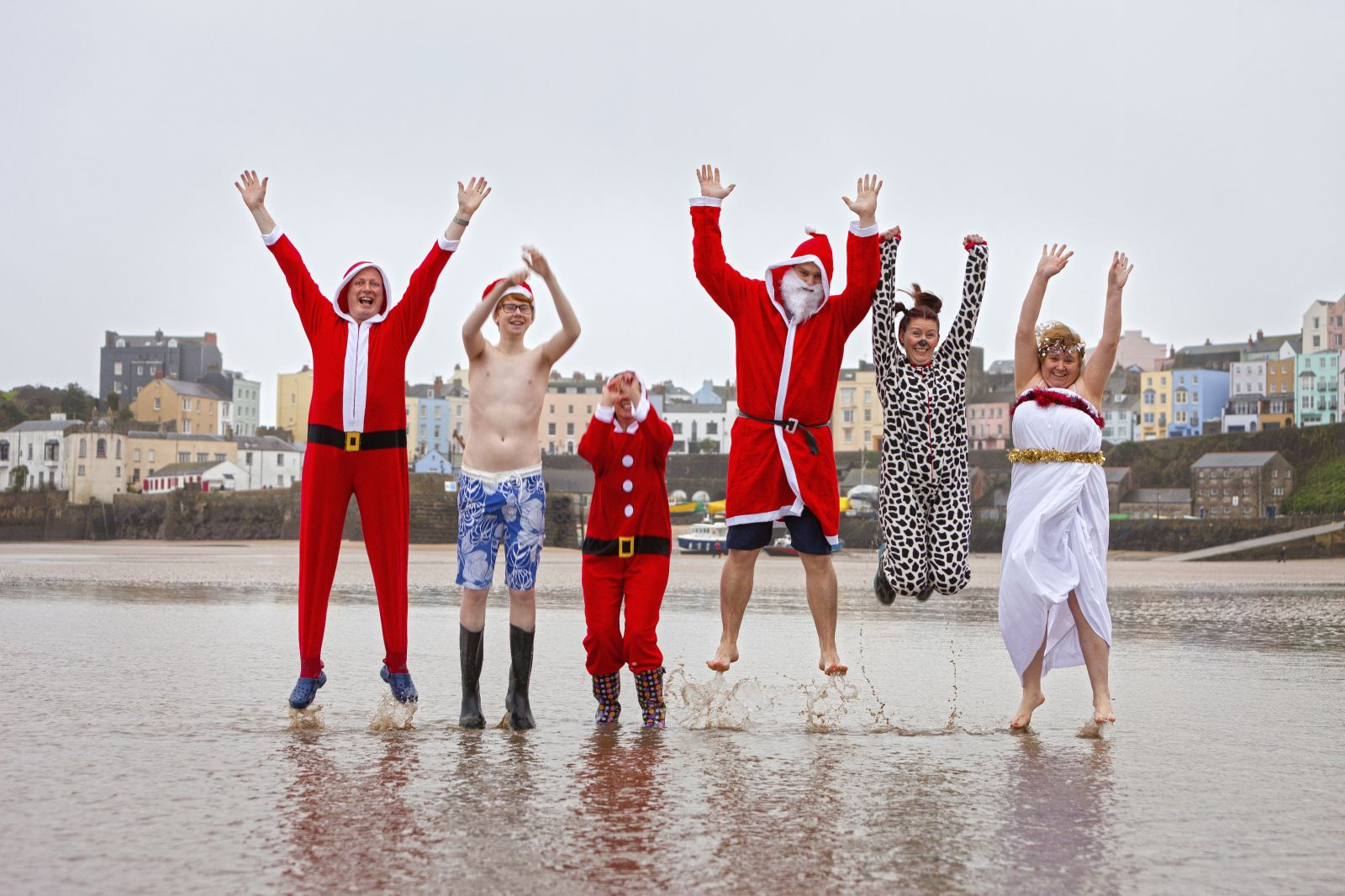 Family on Beach dressed as Father Christmas