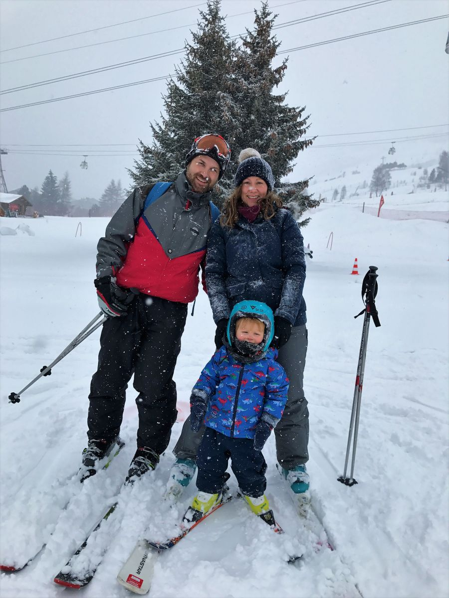 Family of 3 skiing in France